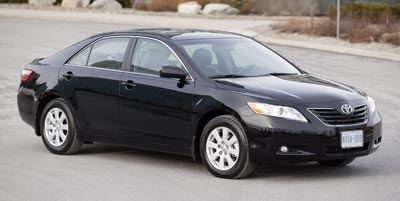 2009_toyota_camry_le_black_96936578854856024